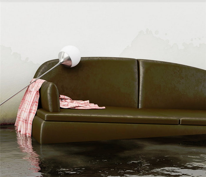 flooded living room with floating couch and tipped over lamp