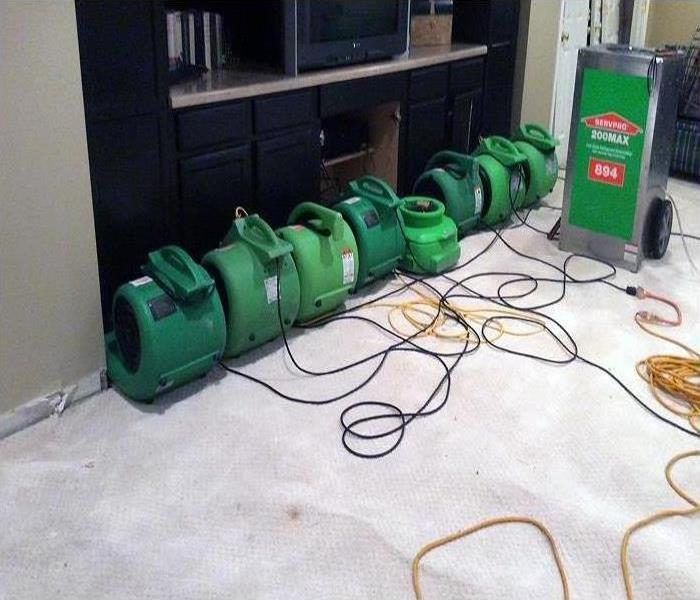 Our high-speed air movers and industrial-grade dehumidifiers working to dry this room