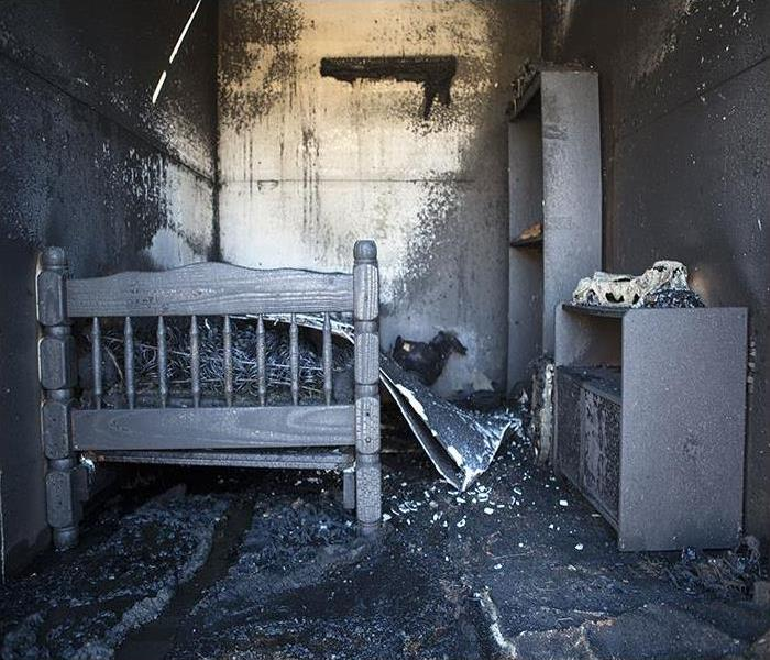 Burned Out Bed Room covered in soot
